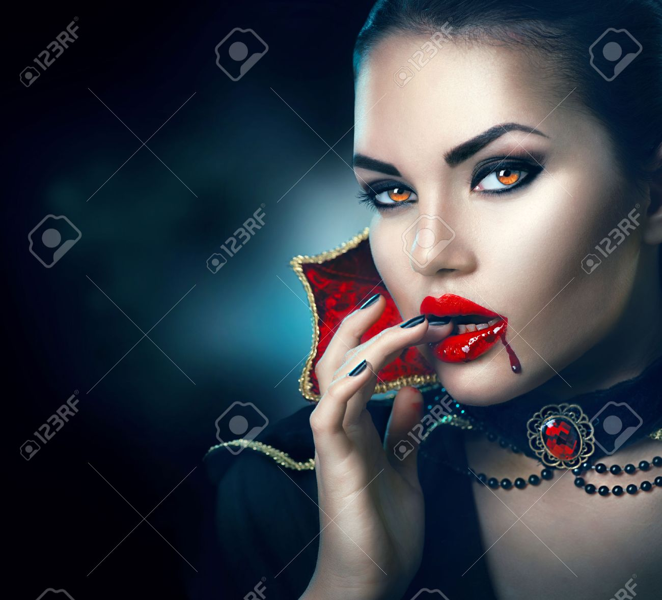 Halloween portrait. Beauty vampire woman with dripping blood on her mouth - 63175211