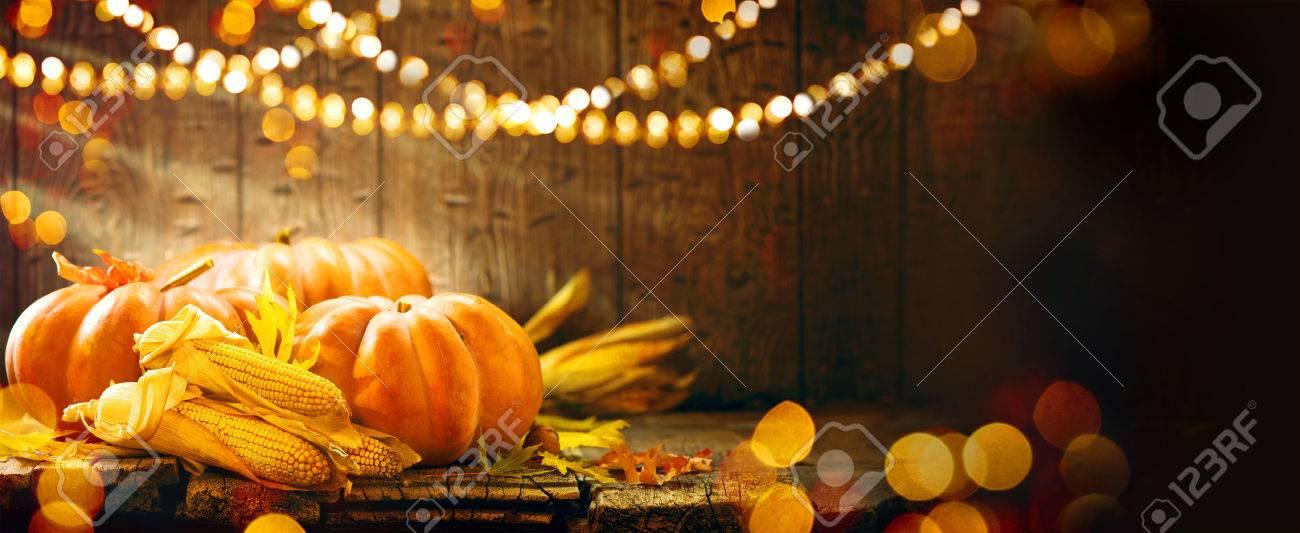 Thanksgiving Day. Autumn Thanksgiving pumpkins over wooden background - 65218101