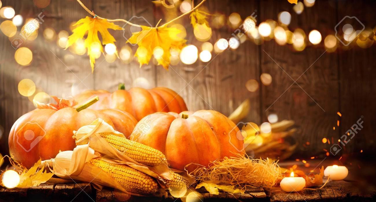 Thanksgiving Day. Autumn Thanksgiving pumpkins over wooden background - 65218348