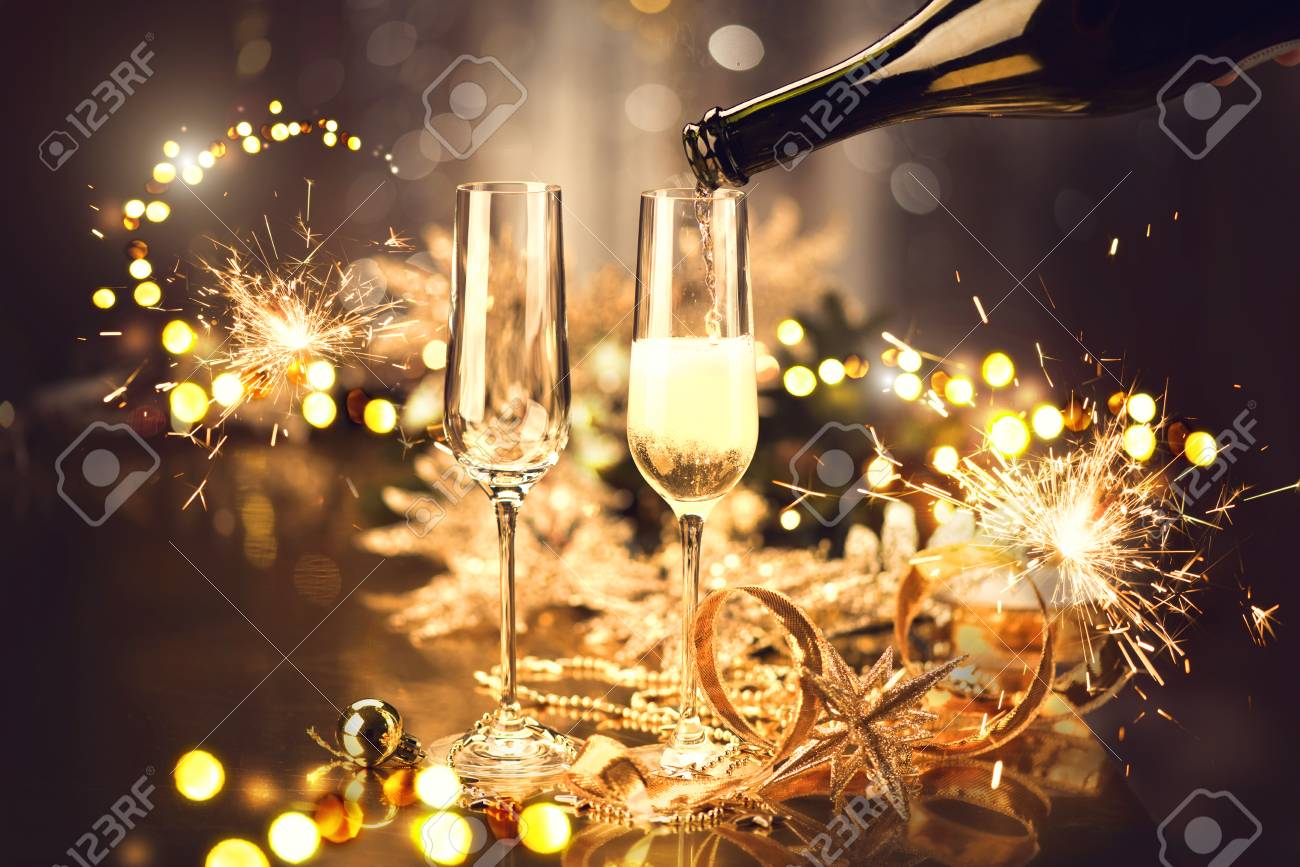 Christmas and celebration with champagne. New Year holiday decorated table - 121753143