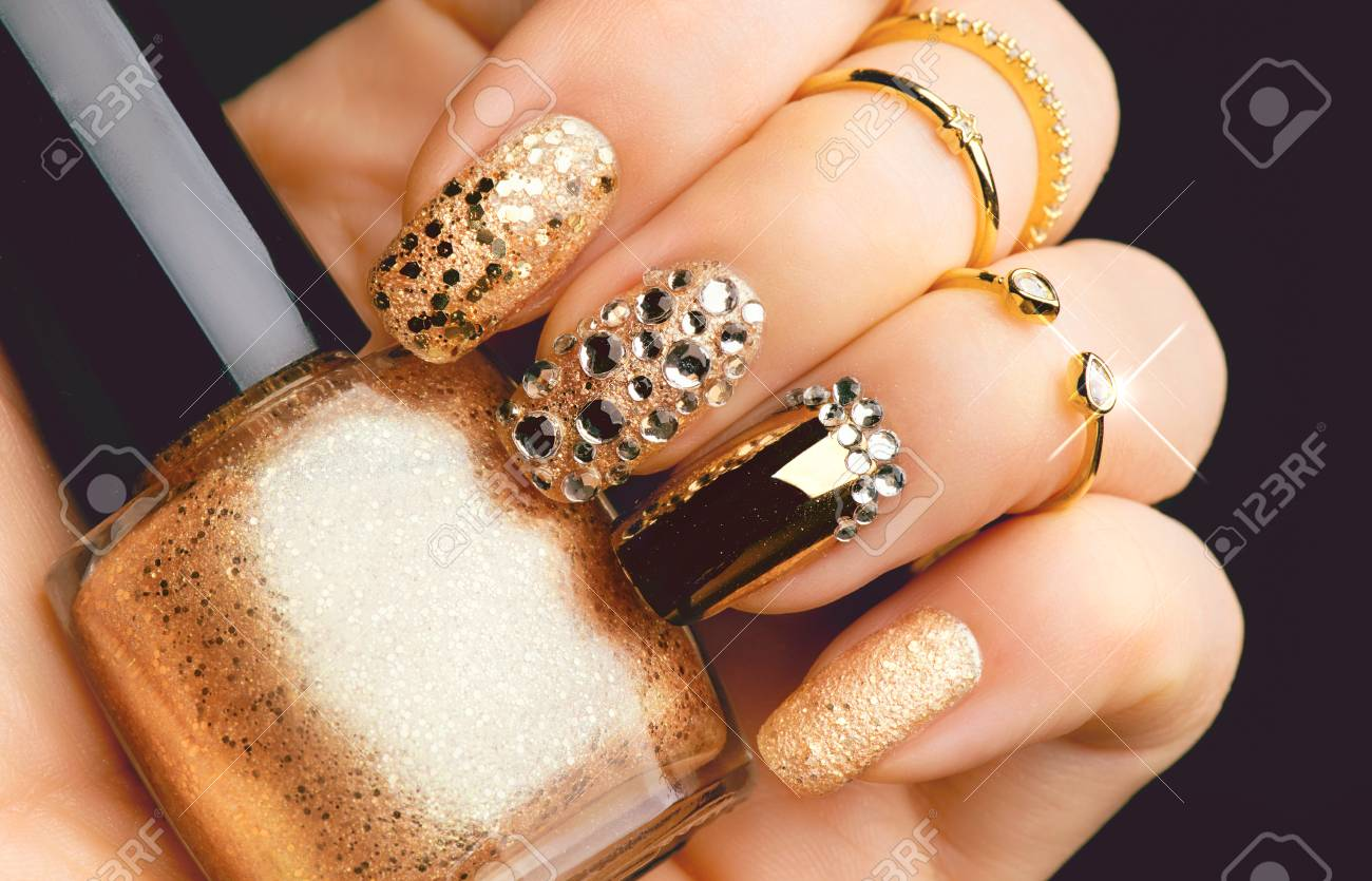 Golden Nail Art Manicure. Holiday Style Bright Manicure With.. Stock ...
