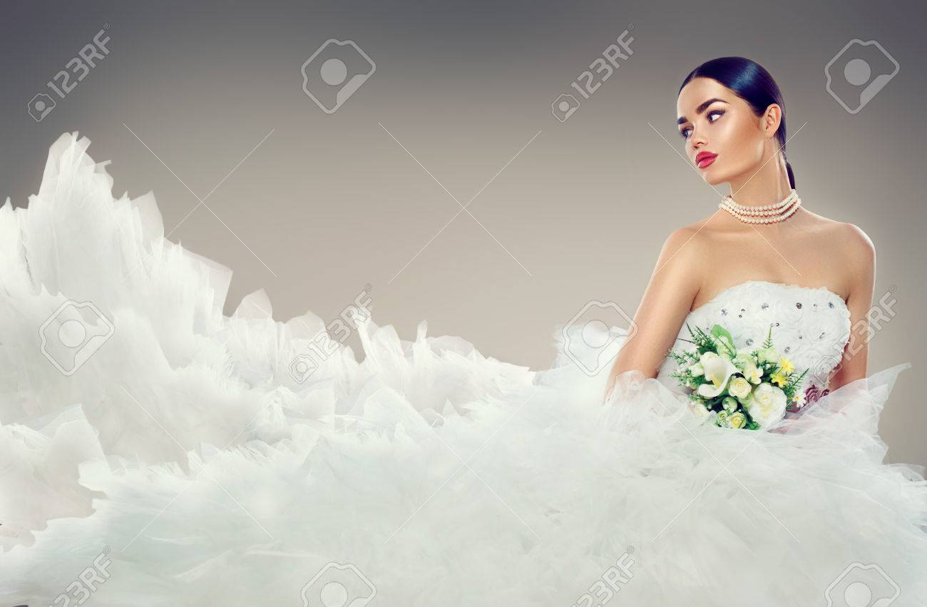 Beauty Model Bride In Wedding Dress With Long Train. Beautiful ...