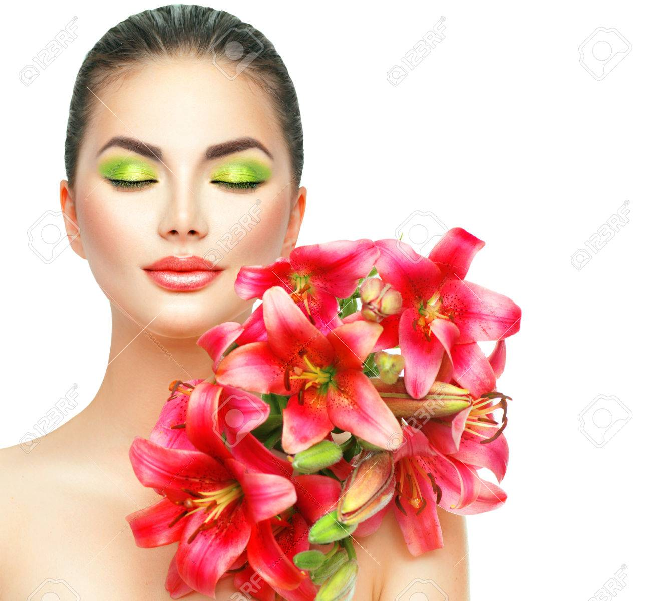 Uncategorized Model Flower beauty girl with lilly flowers bouquet beautiful spa model blooming pink lily stock