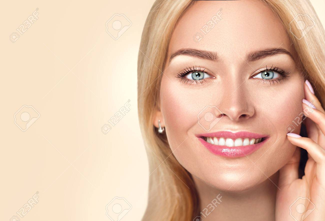 Beauty spa woman touching her face and smiling. Skincare concept - 80688521