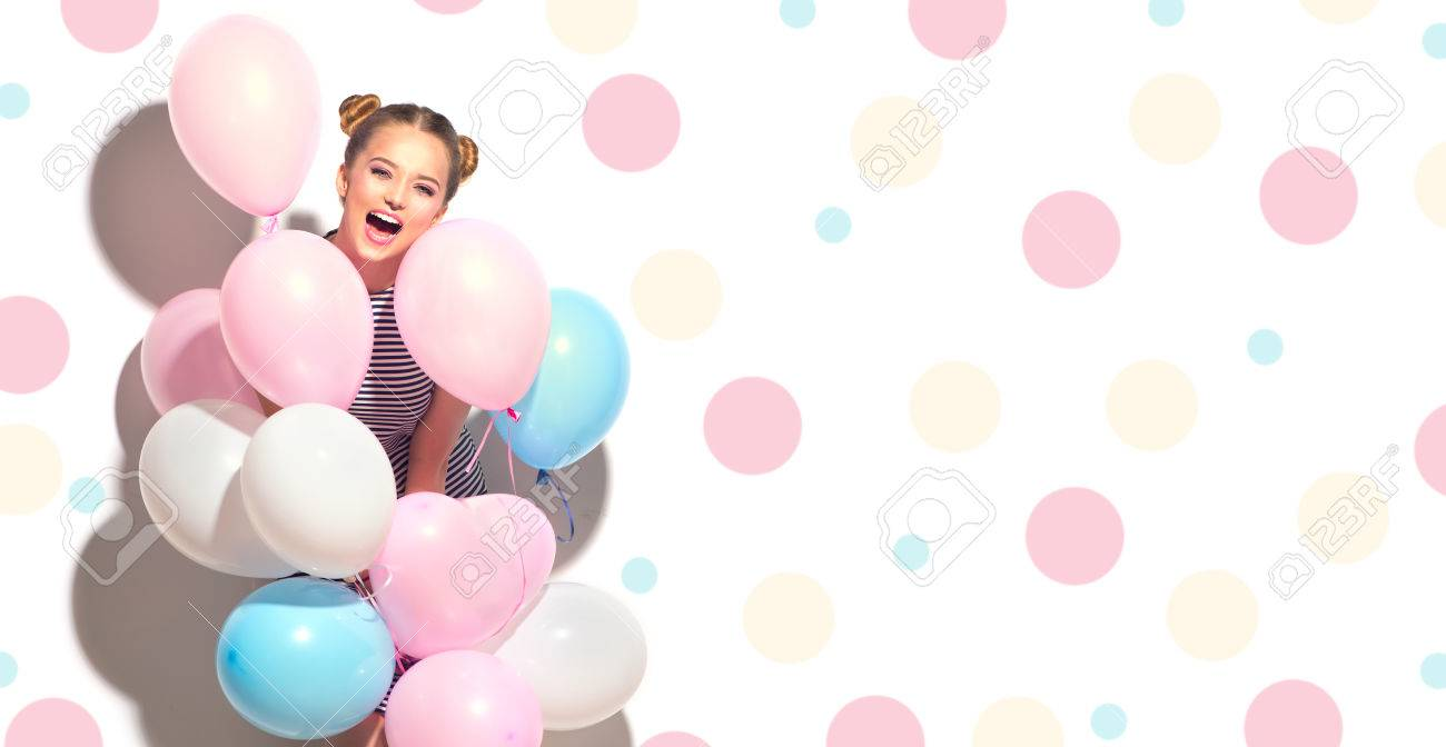Beauty joyful teenage girl with colorful air balloons having fun isolated on white Banque d'images - 84326566