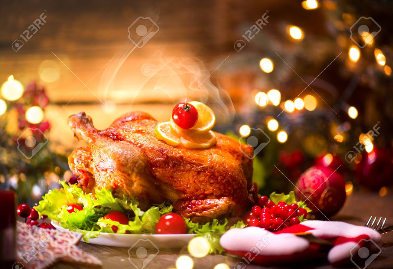Christmas dinner. Decorated holiday table with roasted chicken - 91246887
