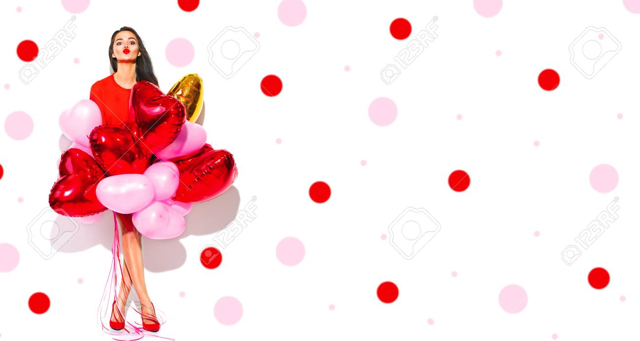 Valentine's Day. Joyful beauty girl with colorful air balloons having fun, isolated on white background. Full length portrait - 93476799