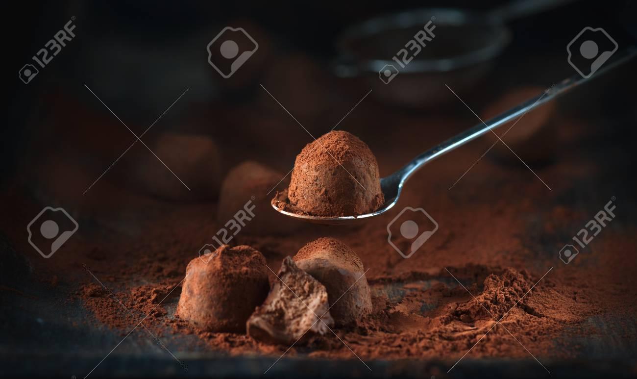 Chocolate truffles. Homemade fresh truffle chocolate candies with cocoa powder - 94190046