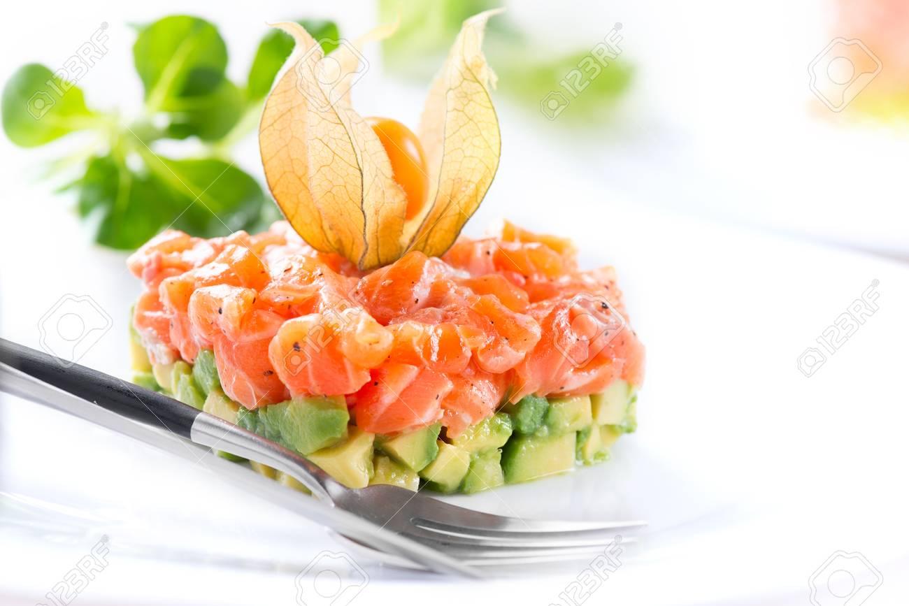 Salmon tartar over white background. Gourmet Food. Starter. Healthy dinner - 96466663