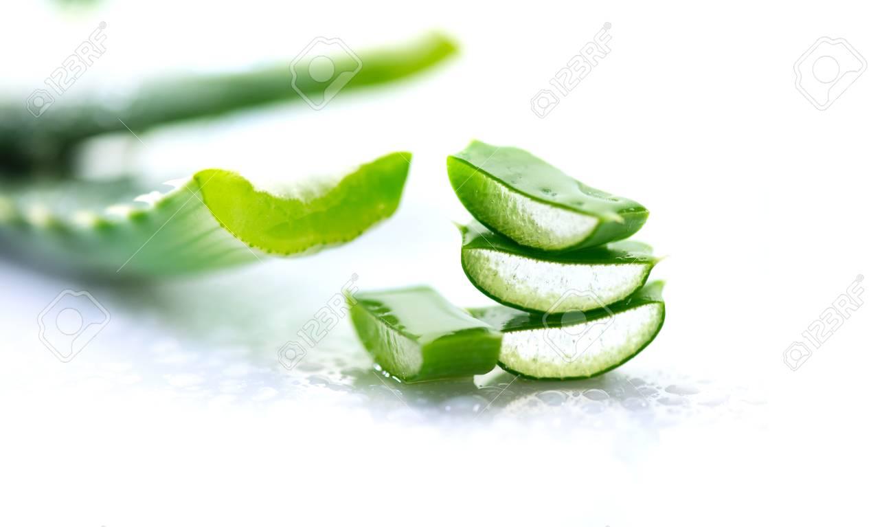 Aloe Vera closeup. Sliced Aloevera natural organic renewal cosmetics, alternative medicine. Organic skincare concept. On white wooden background - 96466676
