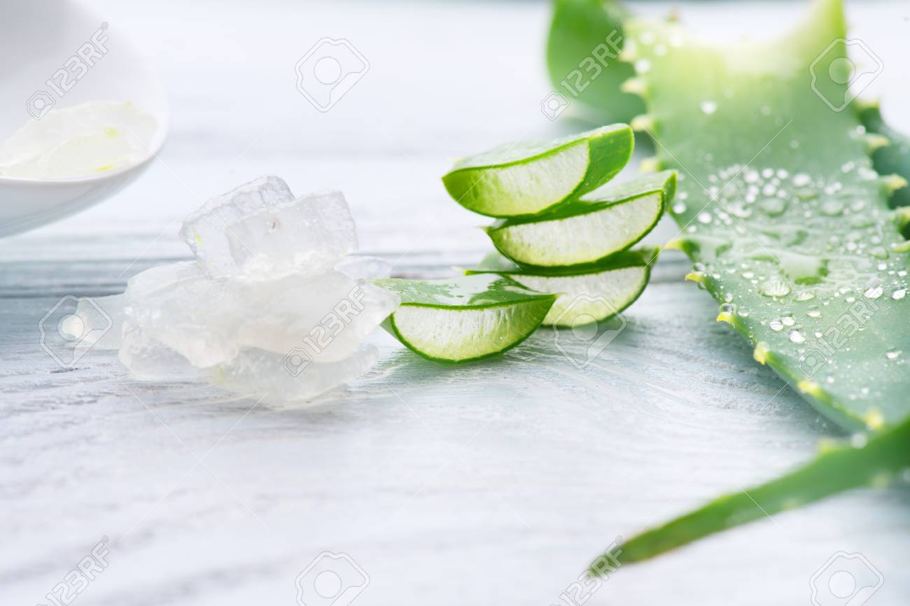 Aloe Vera gel closeup. Sliced Aloevera natural organic renewal cosmetics, alternative medicine. Organic skincare concept. On white wooden background - 96466679