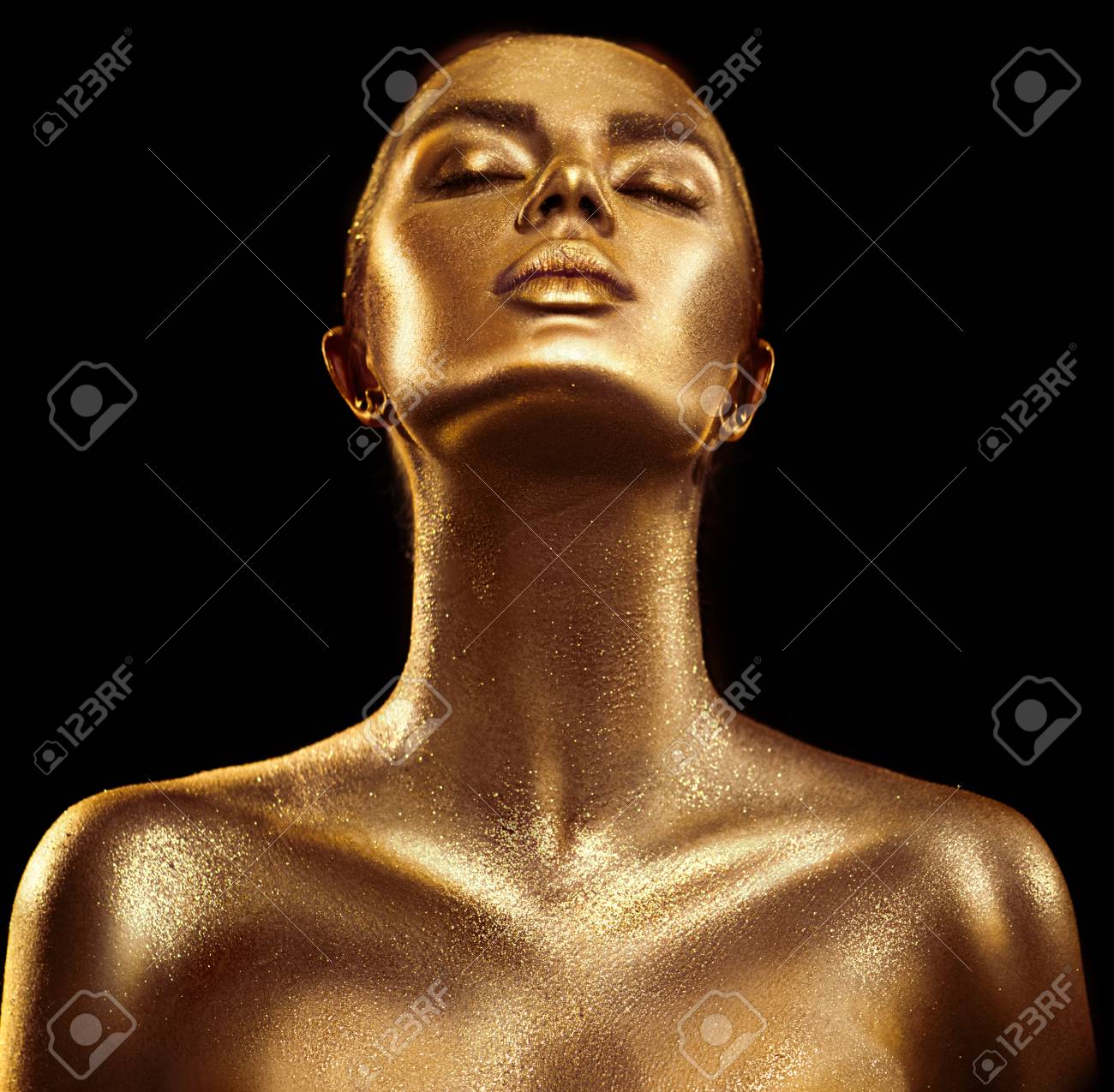 Fashion art golden skin woman portrait closeup. Gold, jewelry, accessories. Model girl with golden glamour shiny makeup - 98589011