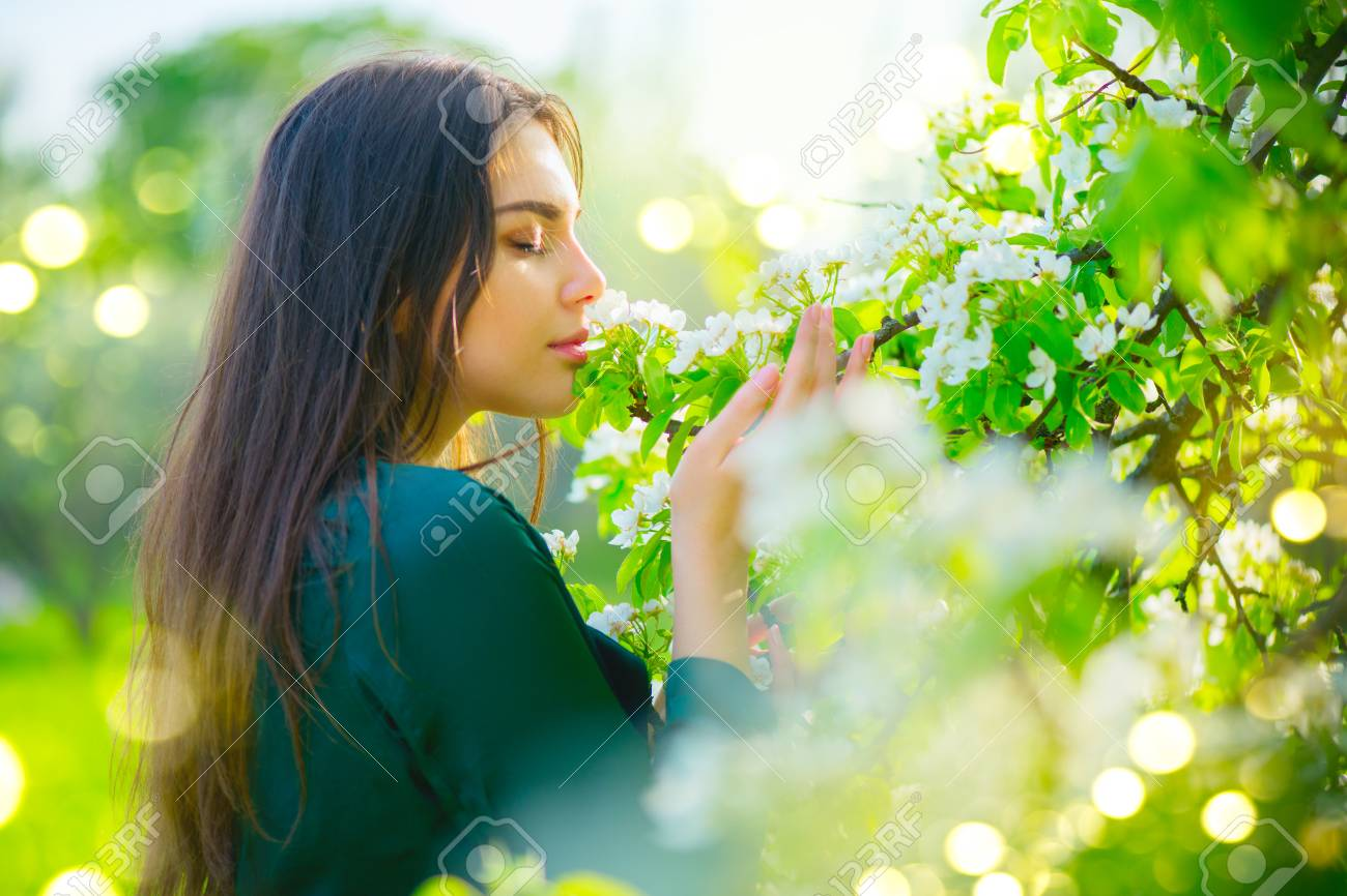 Beauty Young Woman Enjoying Nature In Spring Apple Orchard Happy Stock Photo Picture And Royalty Free Image Image 101799466