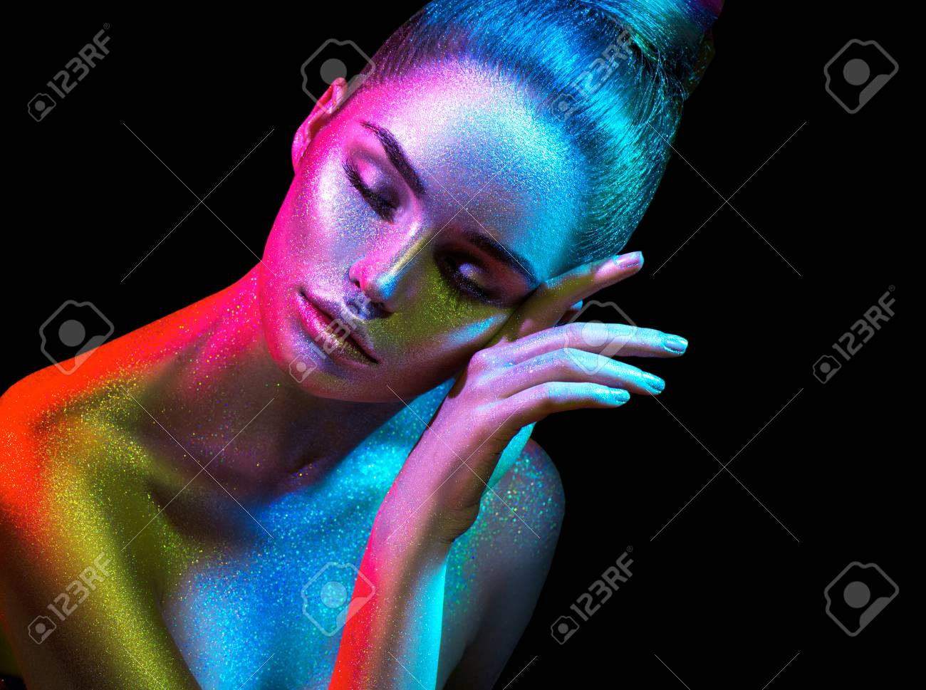 Fashion model woman in colorful bright sparkles and neon lights posing in studio, portrait of beautiful girl. Art design colorful vivid makeup - 102992183
