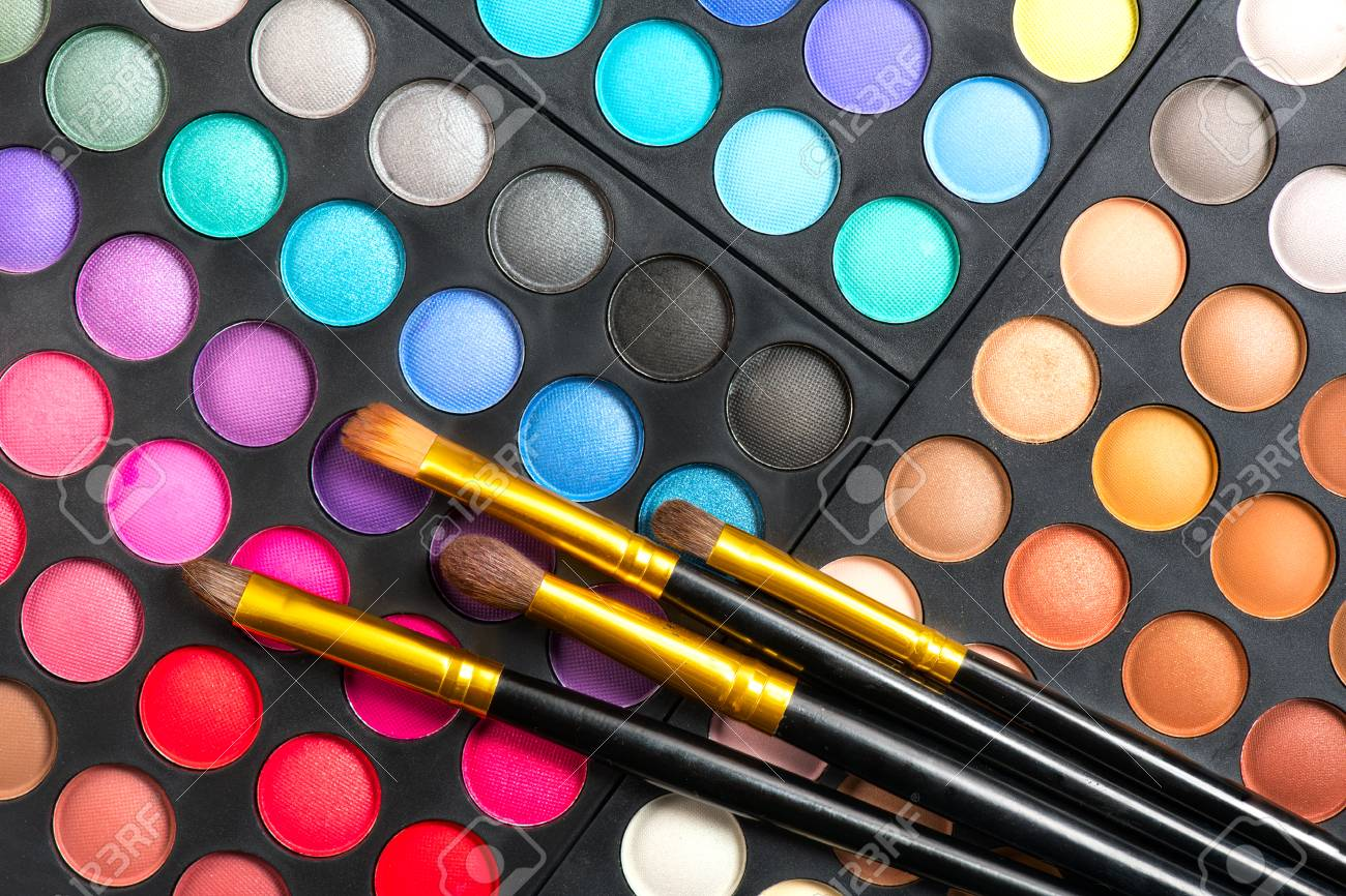 Makeup set. Professional multicolor make up eyeshadows palette and brushes, bright vivid colors and tints of eye shadows set background - 115138955