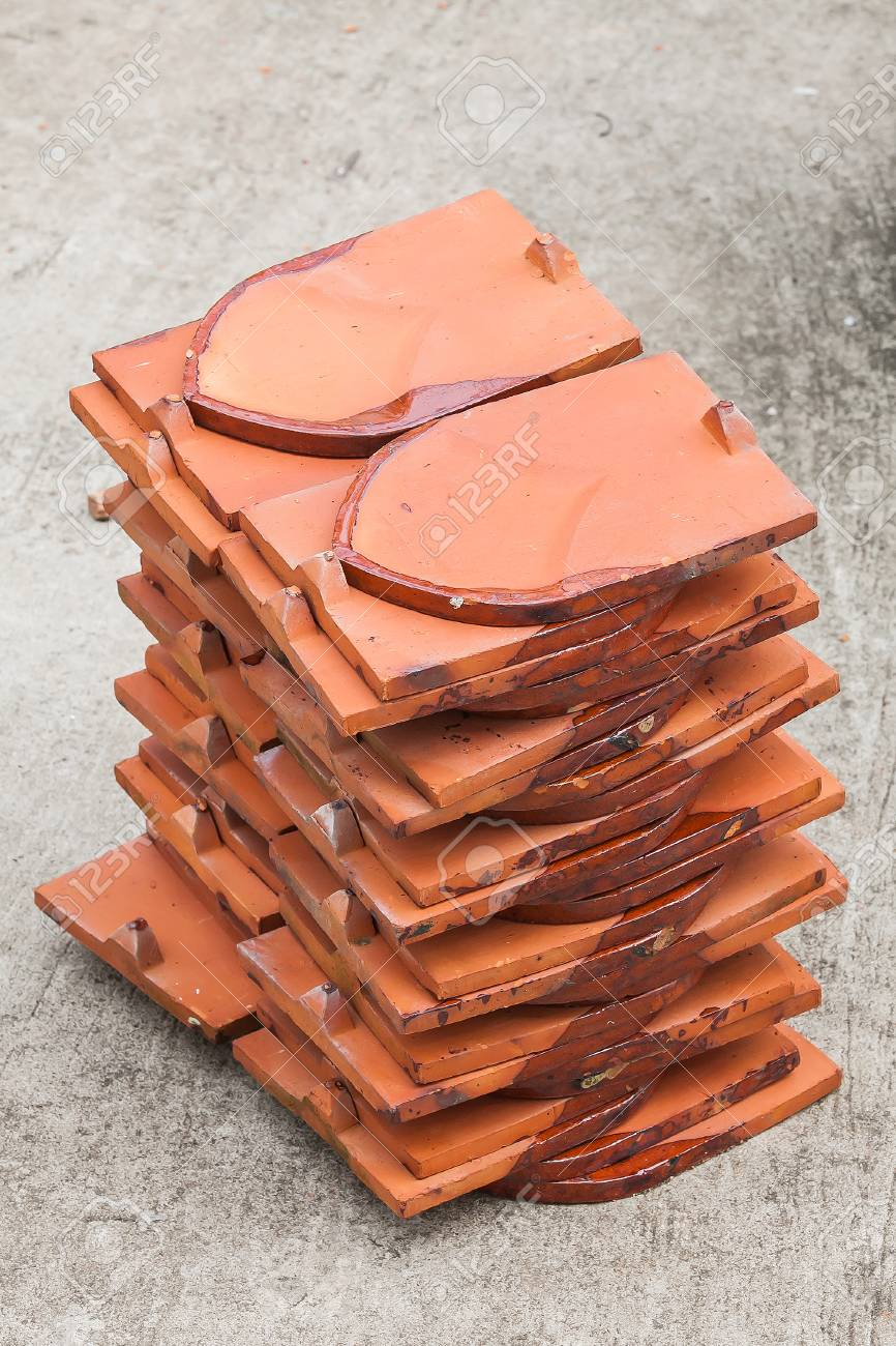 Brown temple roof tiles on cement ground