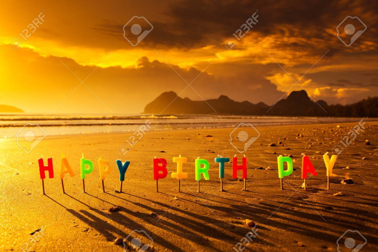 Happy Birthday Colorful Candles On A Beach Stock Photo