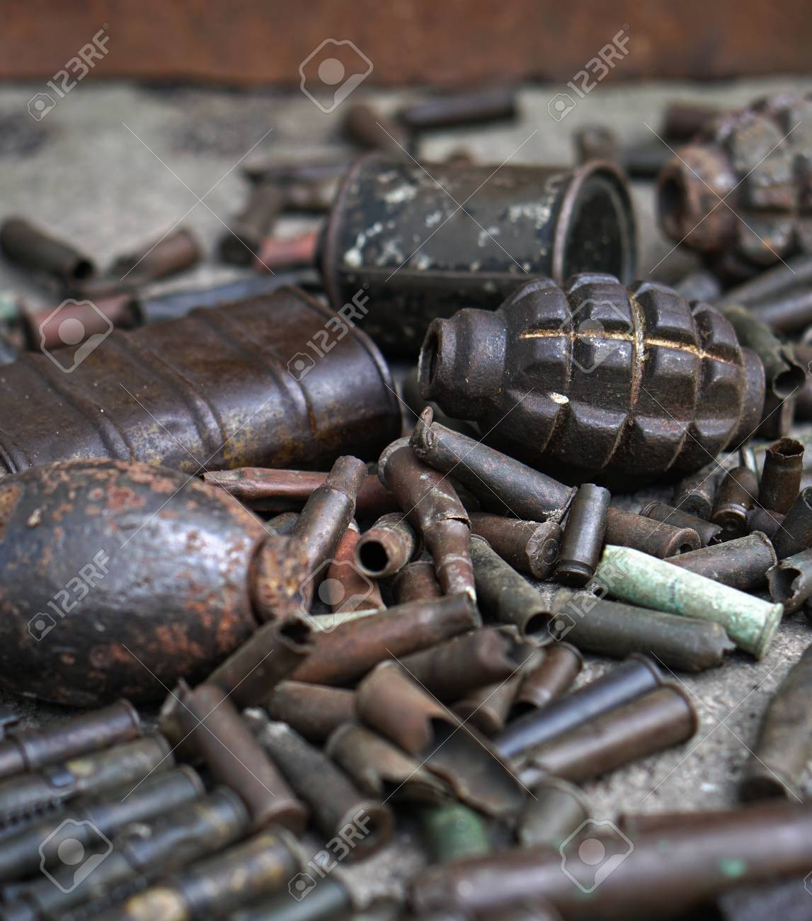 Military background with cartridges of grenades and machine-gun