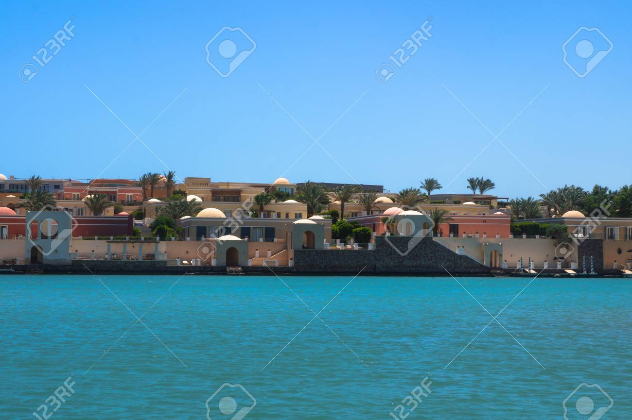 Beautiful view of the coastline with houses and hotels on the red sea. Tourist region in Egypt. Hurghada and its traditions. Stock photo for design - 110842537