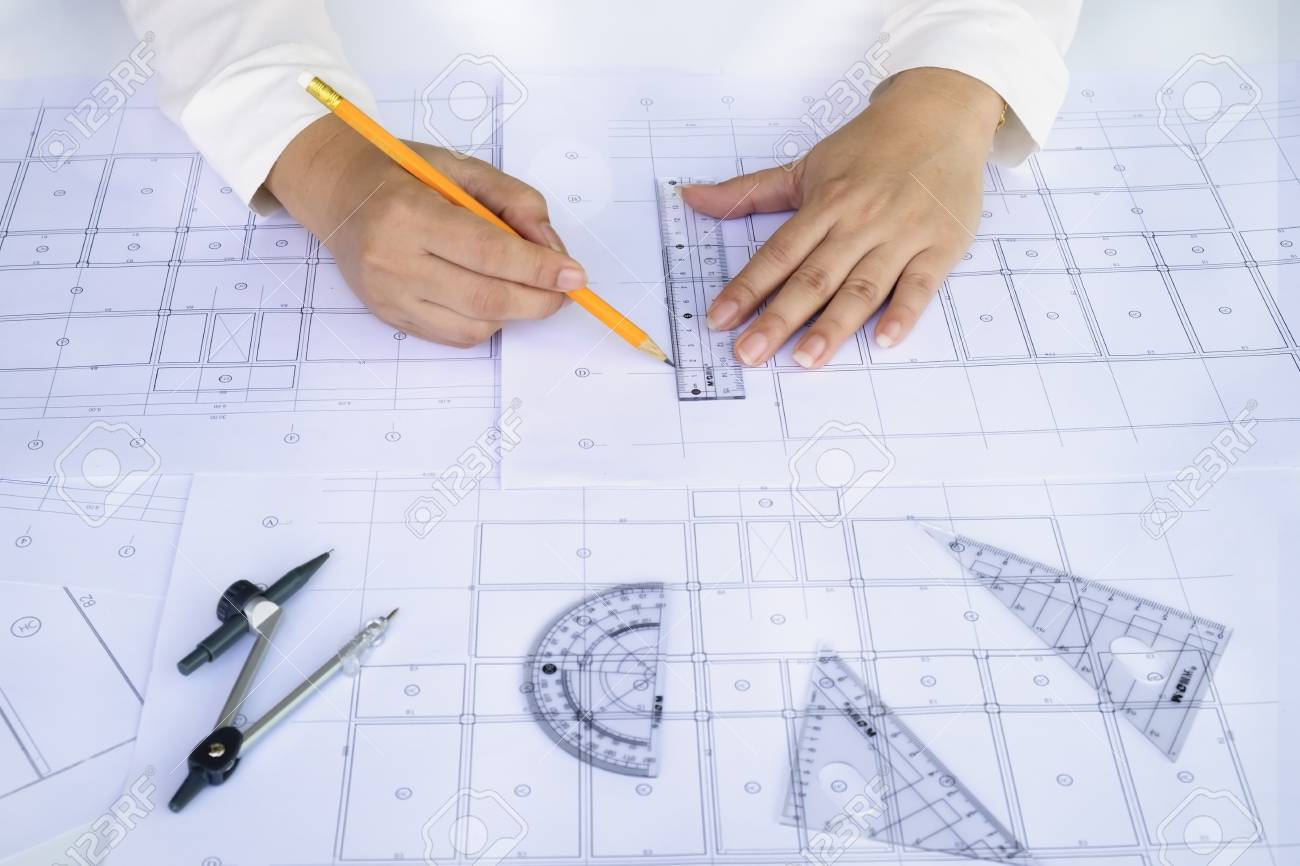 Close up architect working on blueprint architects workplace close up architect working on blueprint architects workplace architectural working of architect sketching a malvernweather Image collections
