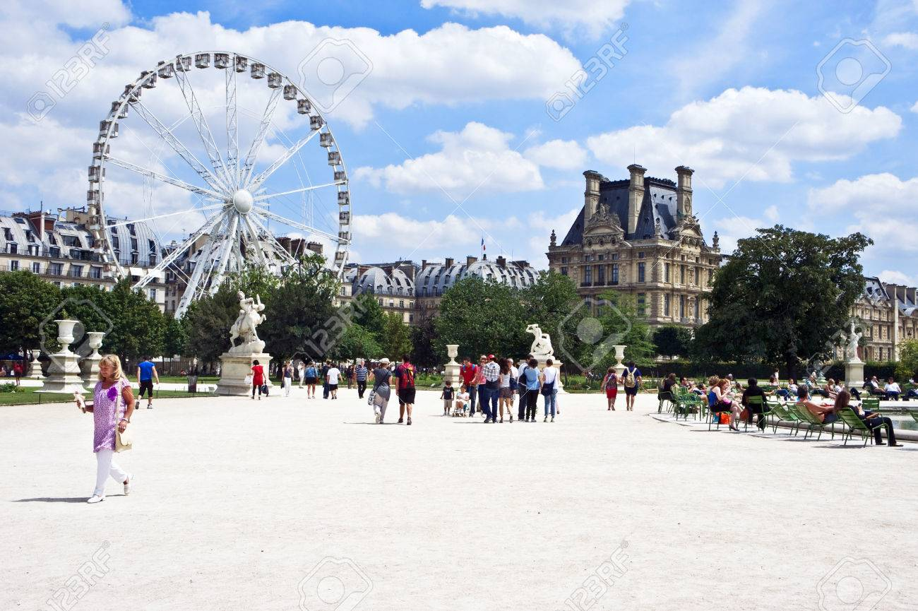 Paris, France - July 7, 2011 - Both Parisians and tourists enjoy a sunny afternoon at the Tuileries Garden (Jardin des Tuileries) in Paris. Recently, France unveiled measures to boost tourism even more in the world's most visited city. Stock Photo - 29401953