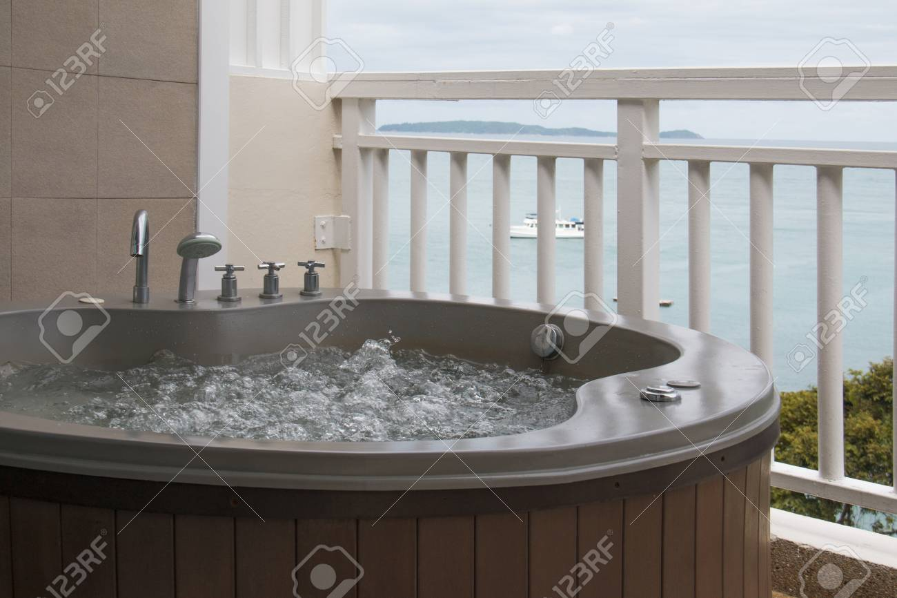 Wooden Bathtub With Swirling Water At Balcony. Stock Photo, Picture ...