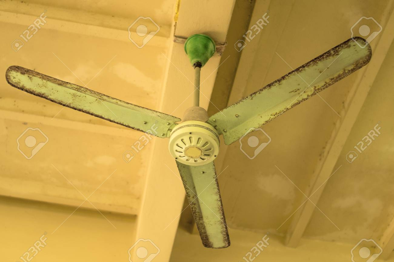 Vintage green ceiling fan on ceiling old ceiling fan with rust stock photo vintage green ceiling fan on ceiling old ceiling fan with rust and dust aloadofball Gallery