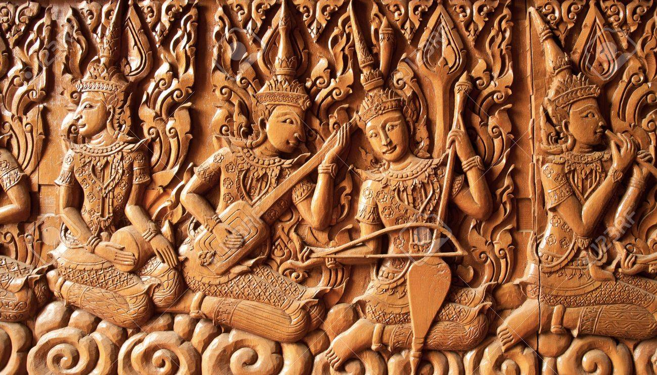 carving angle are playing thai music , buddhist temple ,thailand