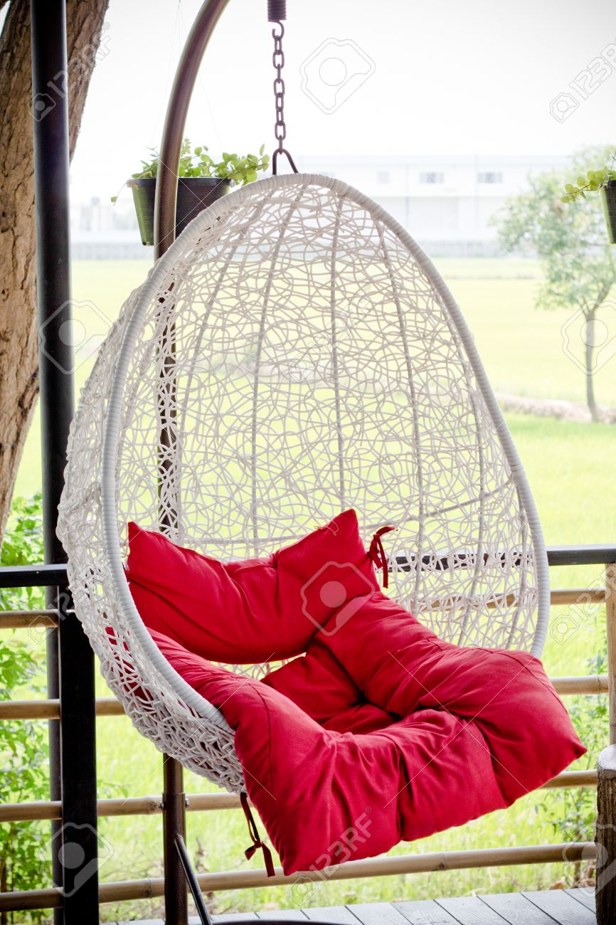 Stock Photo   Vintage Hanging Chair With Red Seat