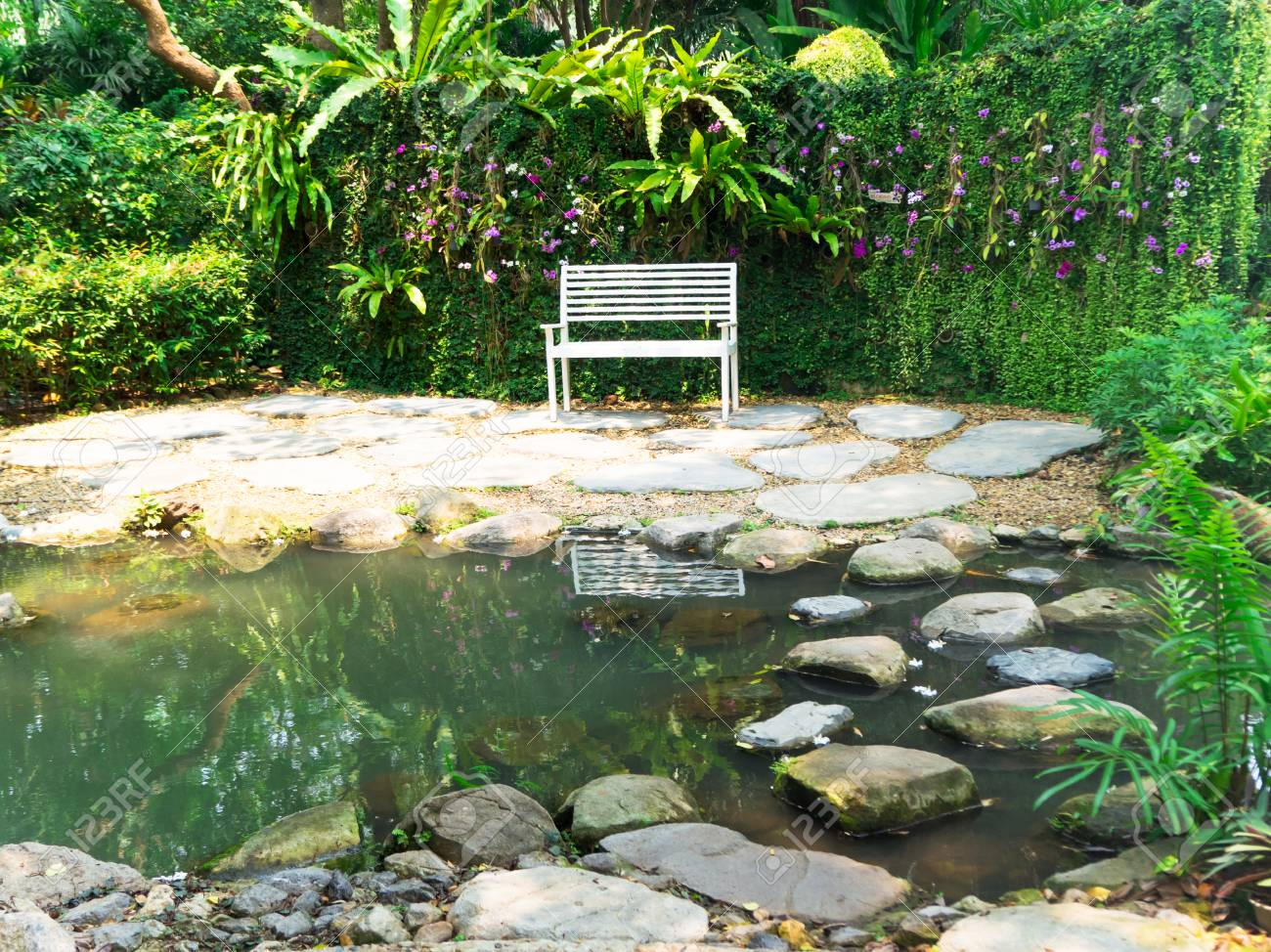 Superb White Bench Locating Among The Garden And Small Pond Gamerscity Chair Design For Home Gamerscityorg