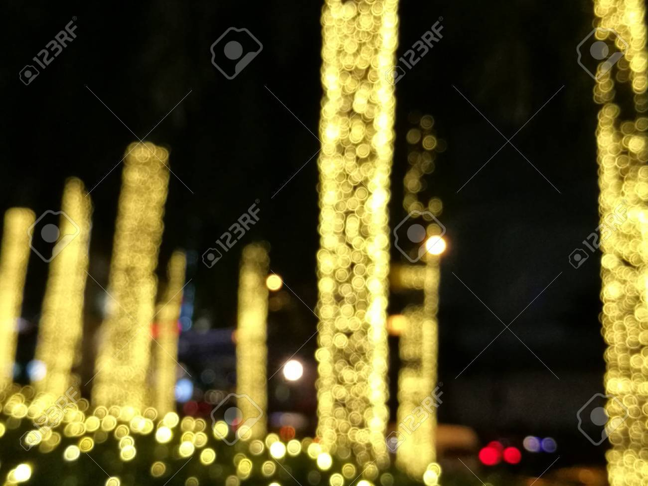 Blur Decorative Outdoor String Lights Bulb Hanging On Tree In The Garden At Night Time