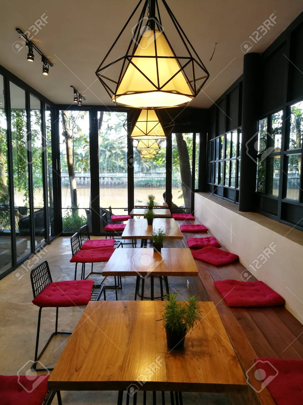 Coffee Shop Interior With Wooden Tables Red Chairs Plant And Stock Photo Picture And Royalty Free Image Image 79842122