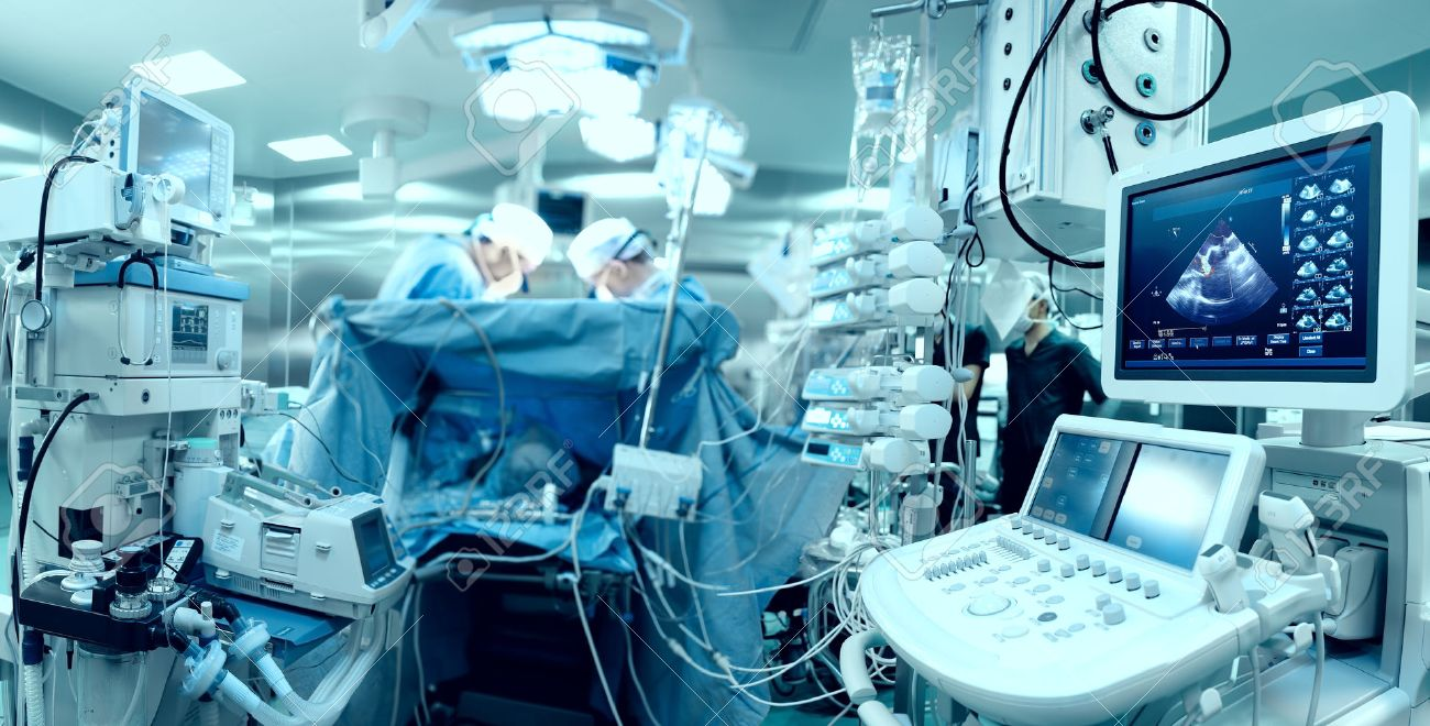 in advanced operating room with lots of equipment patient and