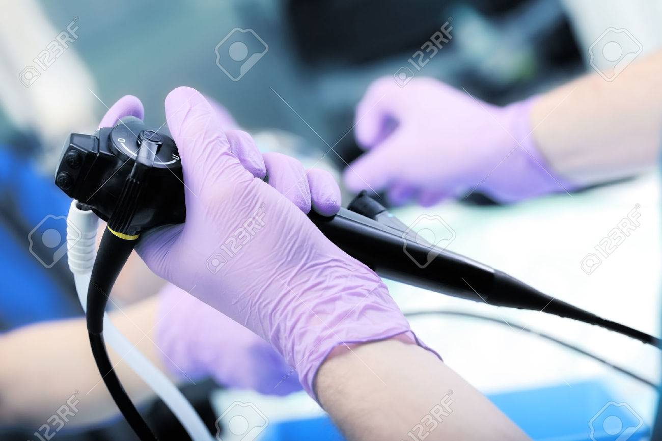 Instrument for endoscopy in the doctor's hands. - 52898532
