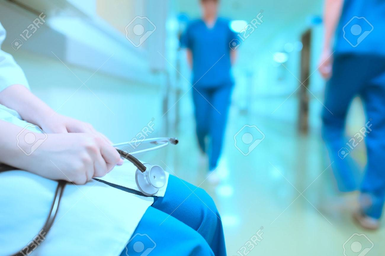 Tired doctor in hospital hall. - 54221141
