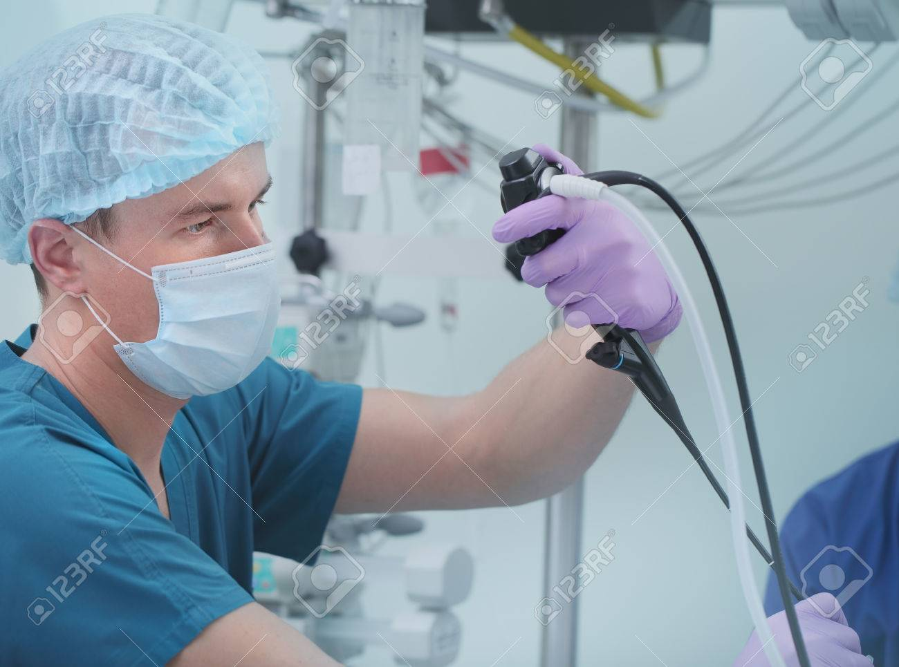Male doctor performing endoscopy research. - 61178475