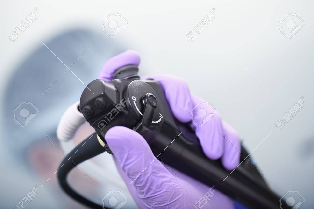 Bronchoscope in the doctor's hand during the procedure - 77148559