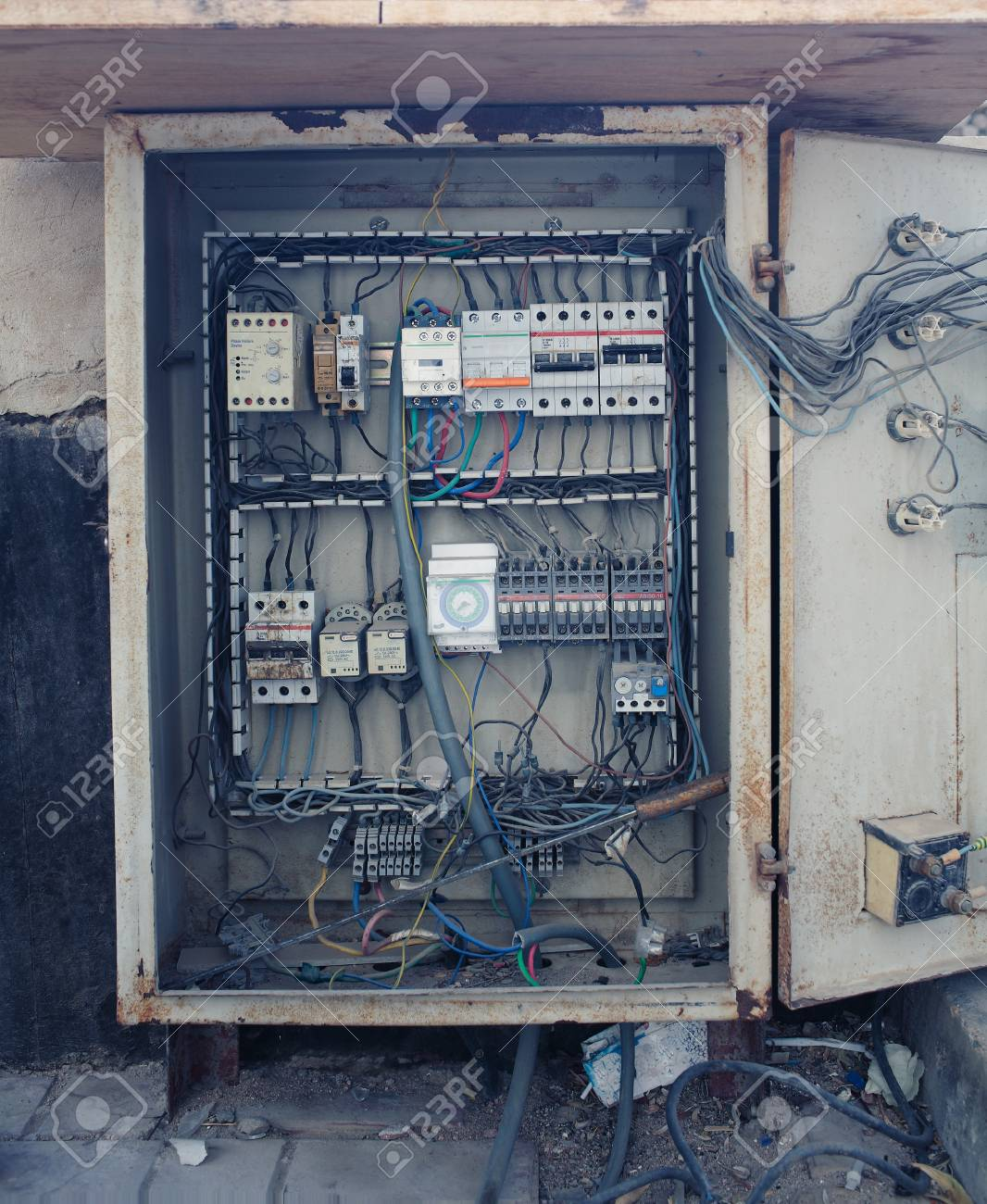 An old open electrical control panel box. Open Electrical Panel on