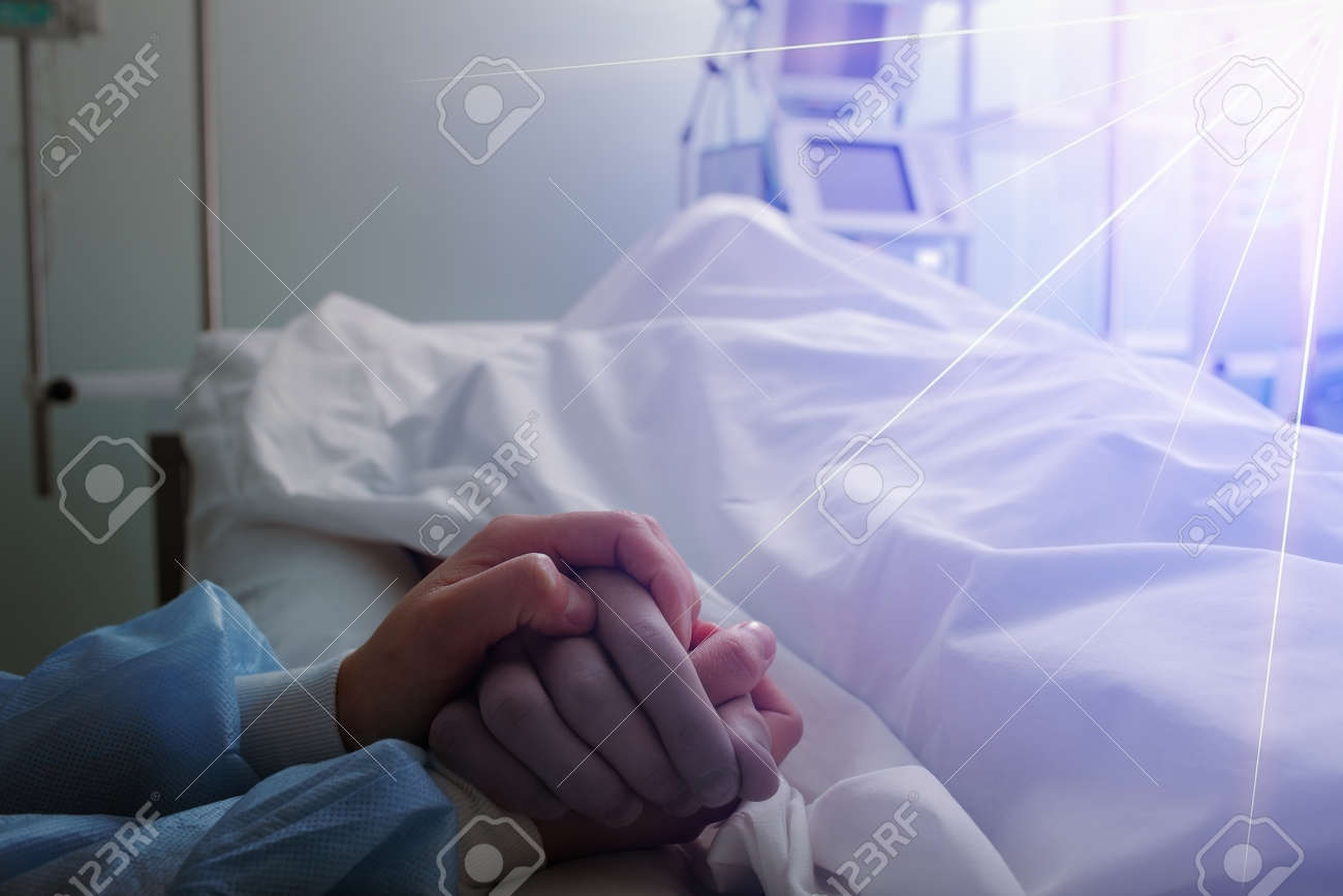 Female nurse holds dead male patient by the hand, concept of general nursing care. - 166853141
