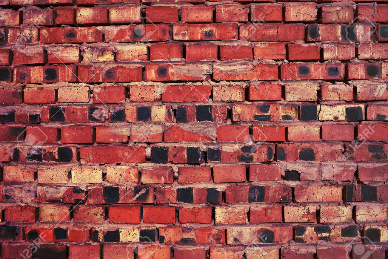 Messy red brick wall as a background with space for design. - 164995123