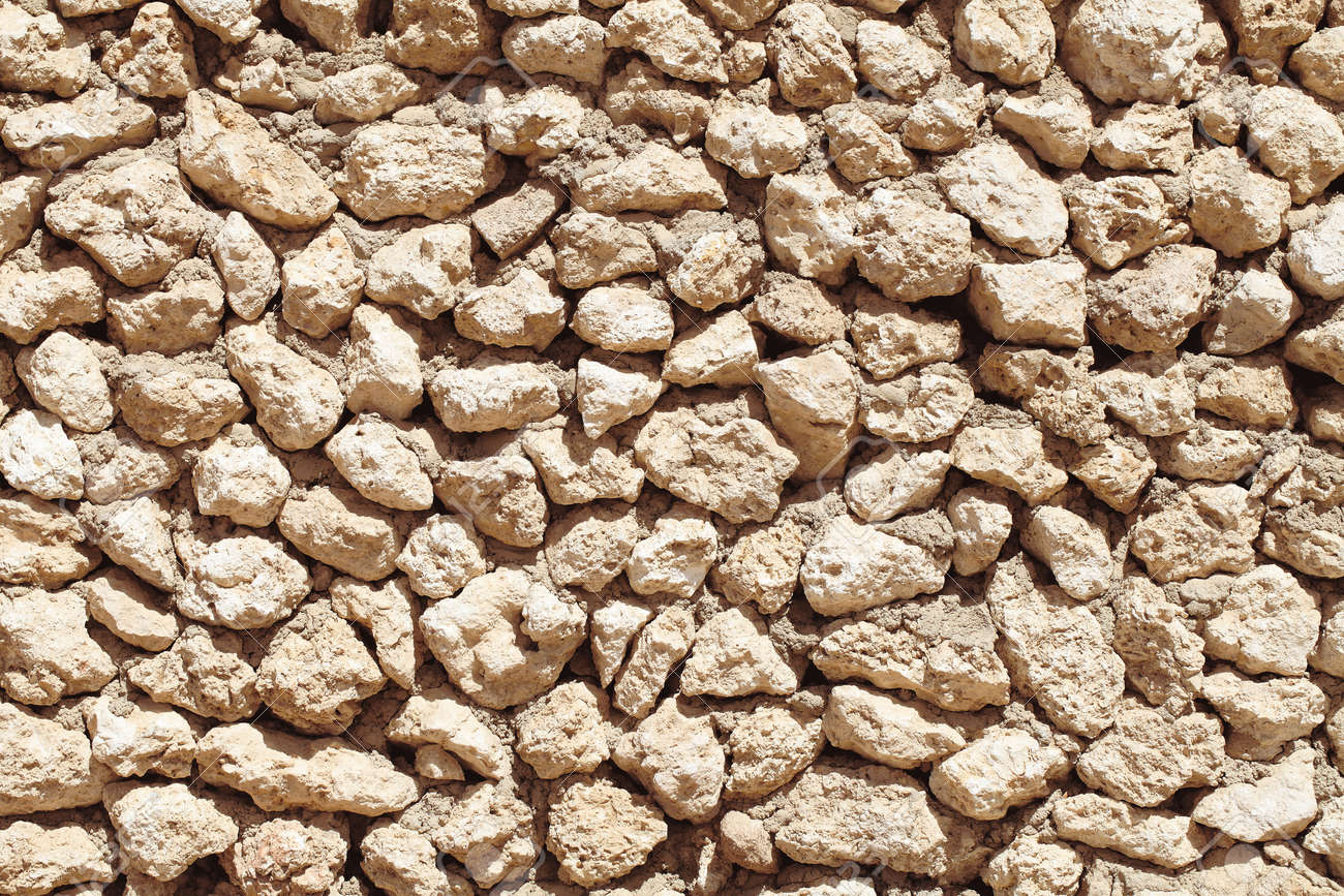 Old stonework wall as an ancient textured background. - 164995124