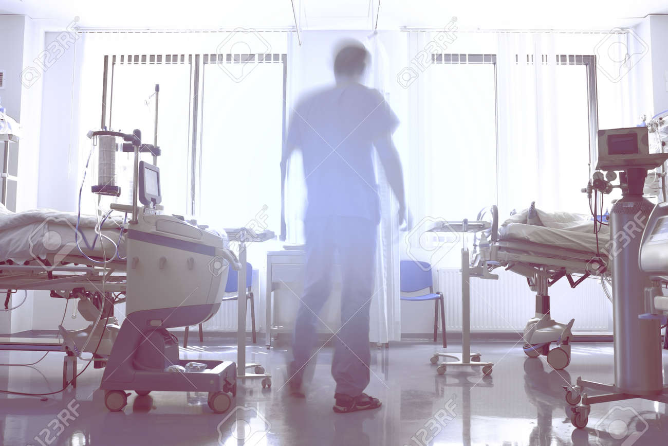 Abstract silhouette of a male doctor in a hospital room. - 166740814