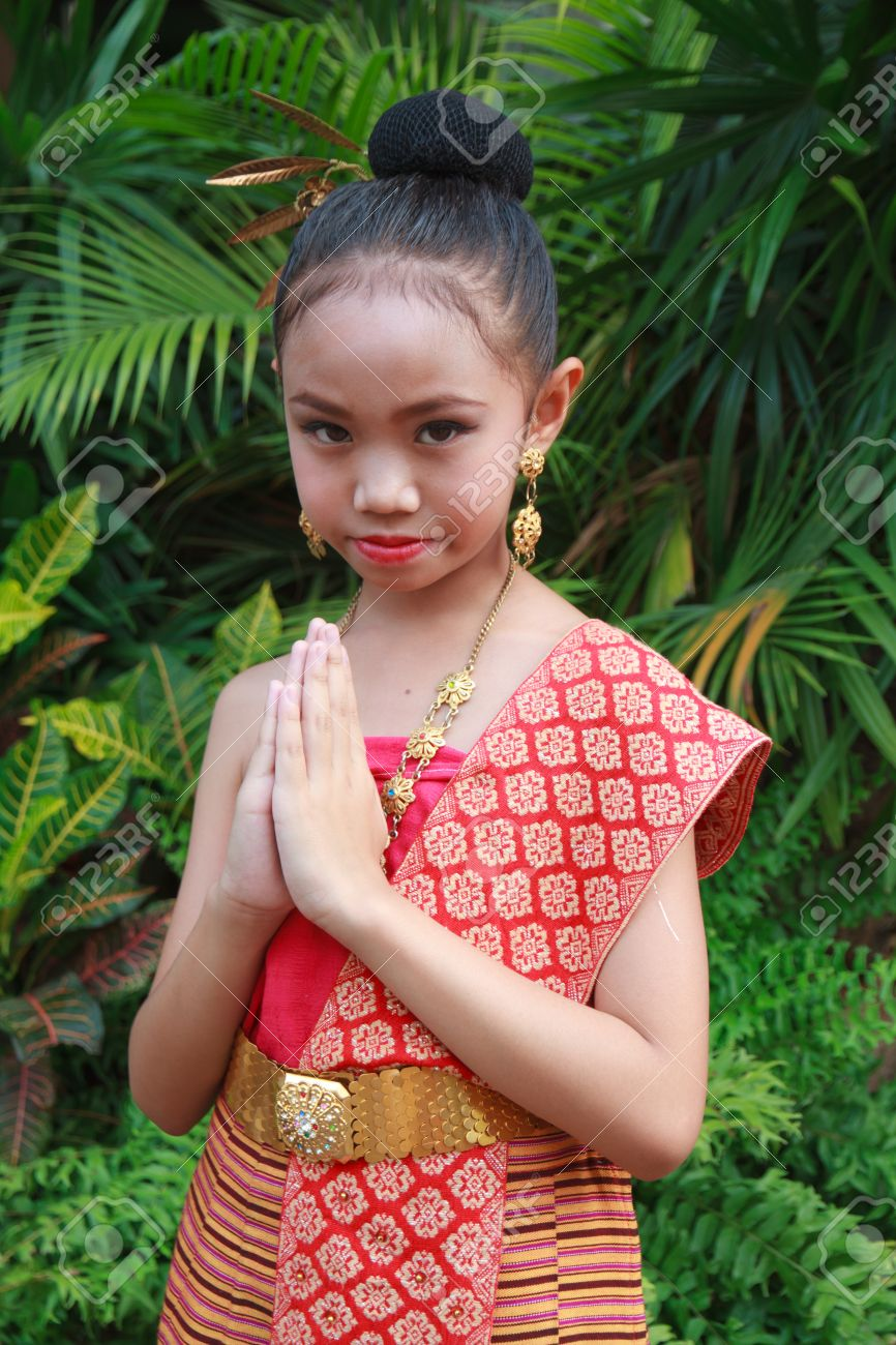 thai child Stock Photo - Thailand child girl wear Thai dress and welcome respect.