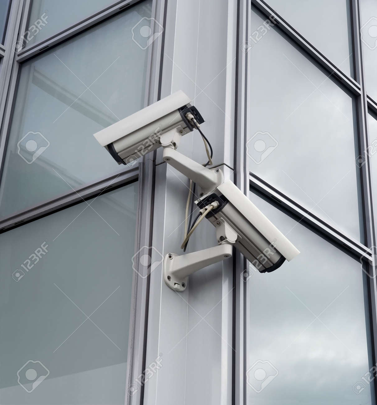 Two security cameras attached on building corner Stock Photo - 962779