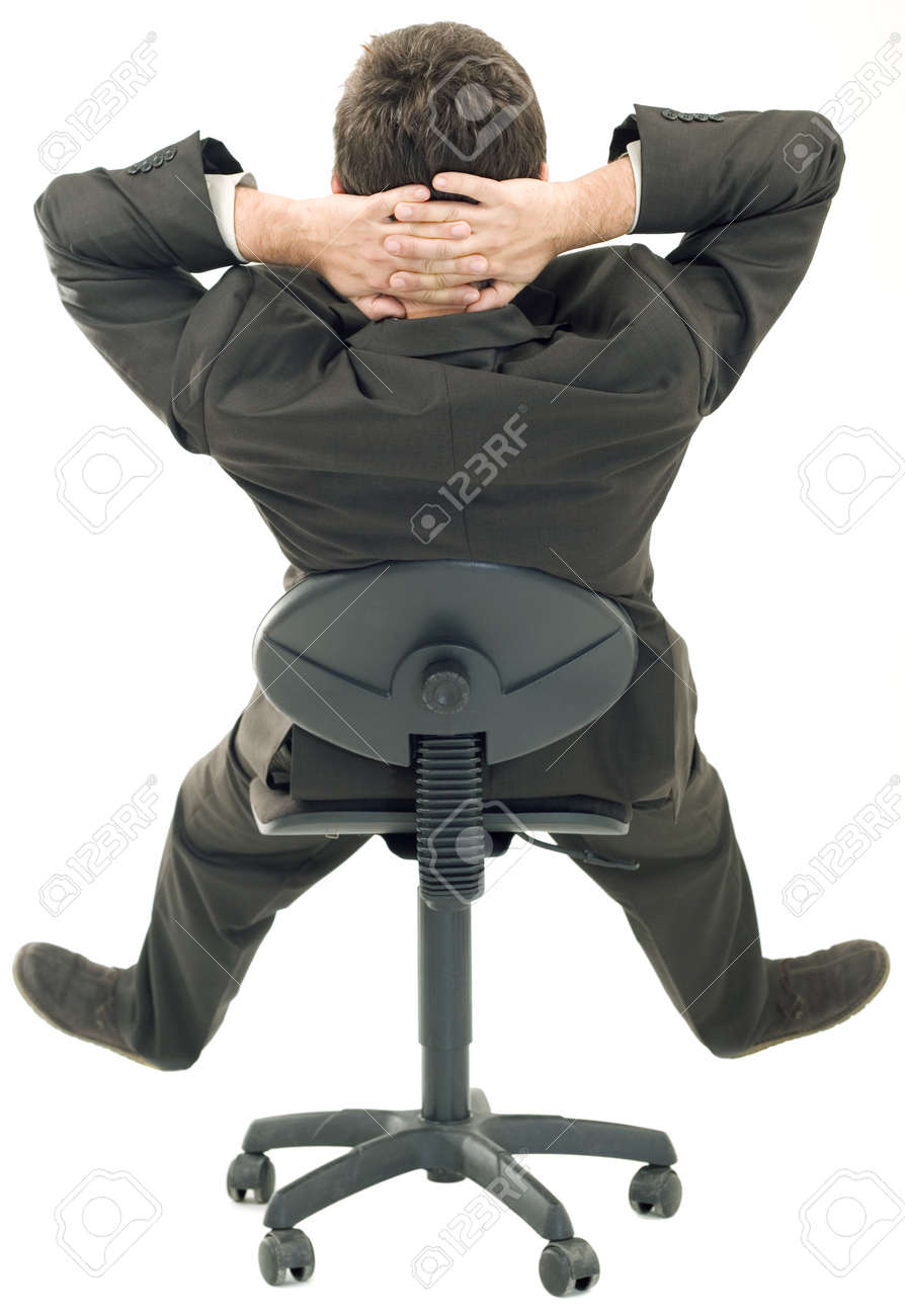 Sitting on a Chair in a relaxed Pose Standard-Bild - 15316975