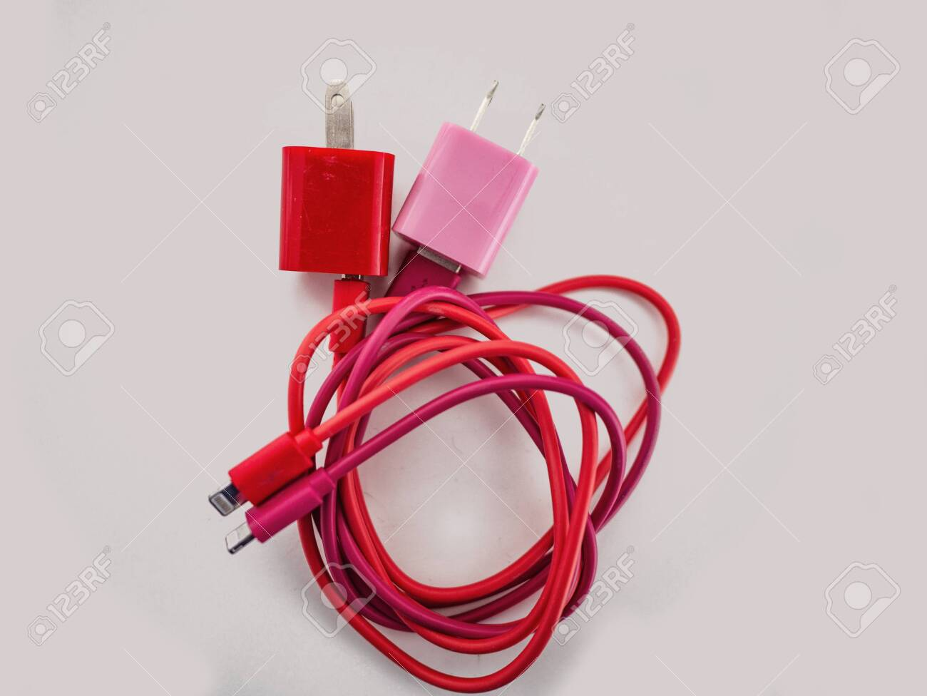 Pink And Red Color Mobile Charger On White Backgroundisolated Wallpaper