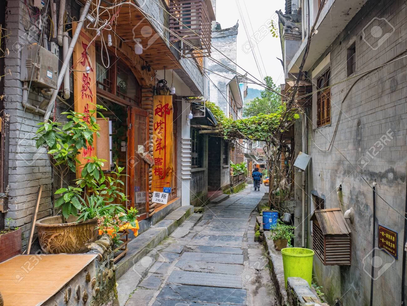 fenghuang,Hunan/China-16 October 2018:Tourist walking in alley building district of Fenghuang ancient town.phoenix ancient town or Fenghuang County is a county of Hunan Province, China - 144639135