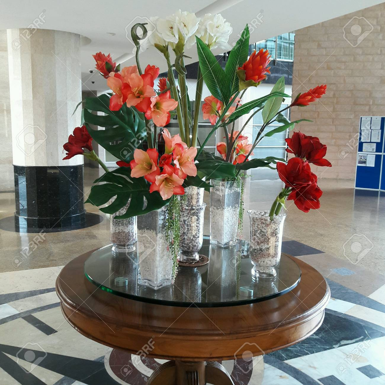 123RF.com & Group of small vases with artificial flowers.