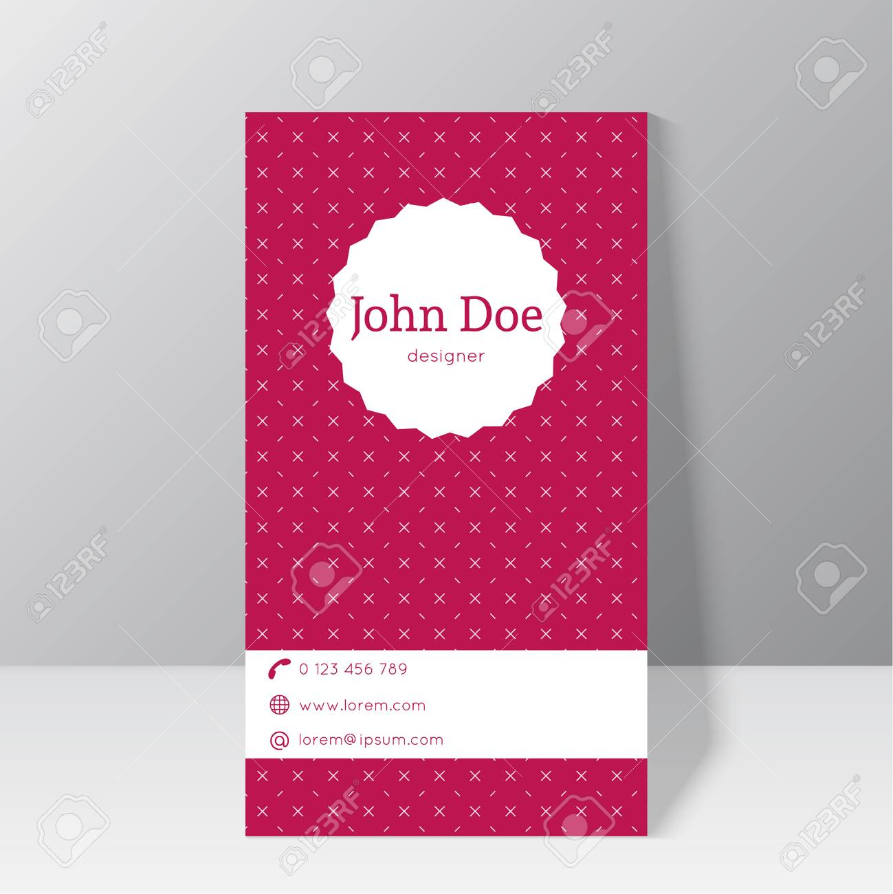 trendy business card template stationary standing near the wall with vintage label and elegant diagonal cross