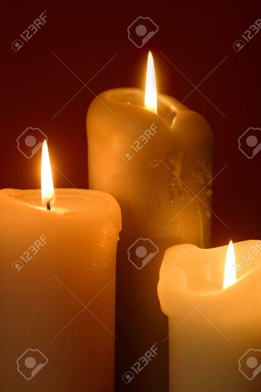 Three Lit Candles As A Background For Christmas Or Religious ...